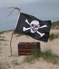 Skull & Crossbones flying over a treasure chest